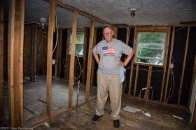 O'neil Couvillion in his gutted home almost a year after the 1000 year flood. He is still waitting on a contracter to rebuild their home in Denham Springs. O'neil is anxious for the work to begin.